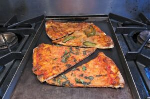 4 pizza slices on the bake pan